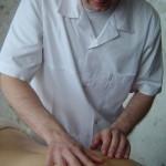 Test palpacyjny ruchomości tkanek miękkich.